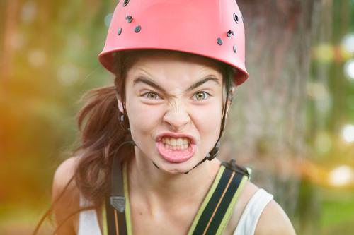 Angry mountaineer Lifestyle Leisure and hobbies Summer vacation Sports Climbing Mountaineering Helmet Human being Feminine Woman Adults Youth (Young adults)