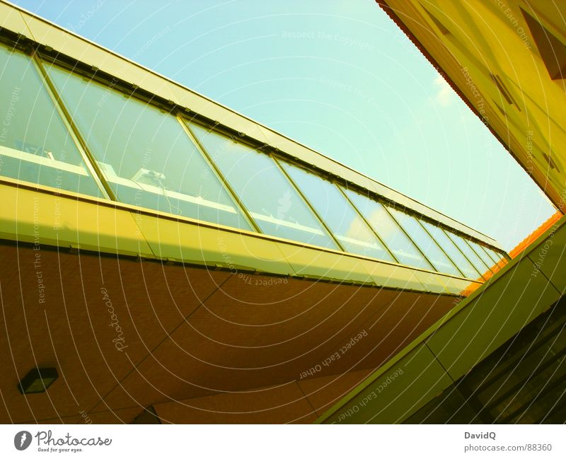 yellow submarine Linearity Yellow Commuter trains Facade Window Window pane Concrete Dimension Geometry Reflection Building Hover Modern Sky Blue Old and New