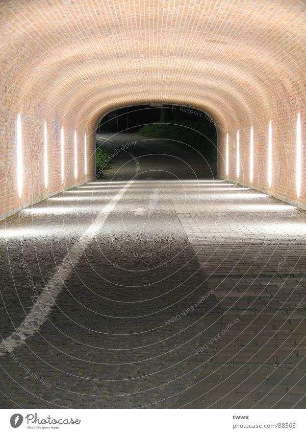 Loneliness Transport Empty Target Infinity Tunnel Brick Direction Sidewalk Cobblestones Doomed Street lighting Neon light Anonymous Pavement