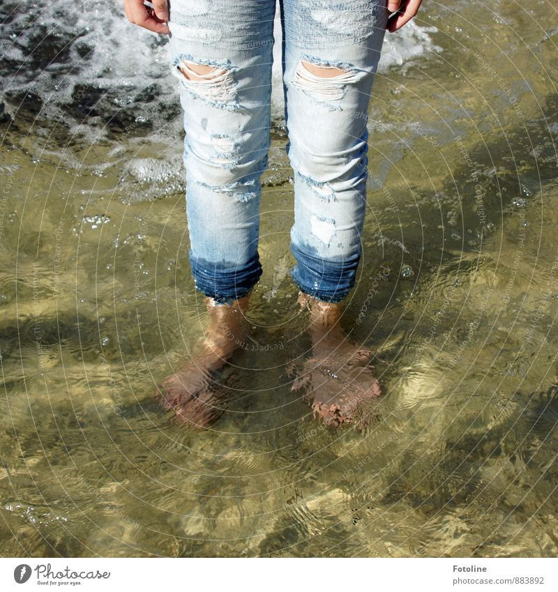 Peace for a carefree childhood. Human being Feminine Girl Infancy Fingers Legs Feet 1 Water Summer Cool (slang) Cold Wet Blue Barefoot Jeans Broken