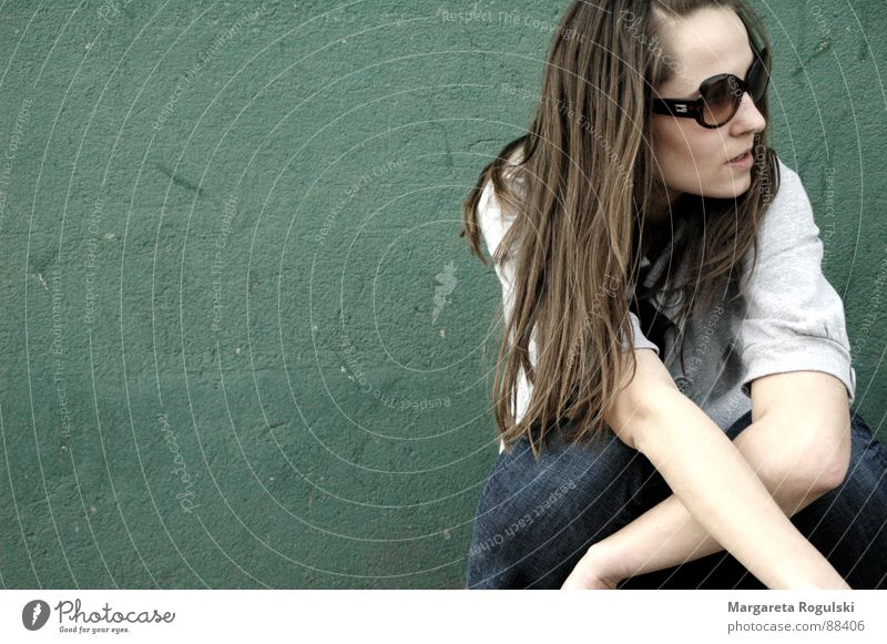 Woman Green Relaxation Wall (building) Hair and hairstyles Wall (barrier) Eyeglasses Kneel