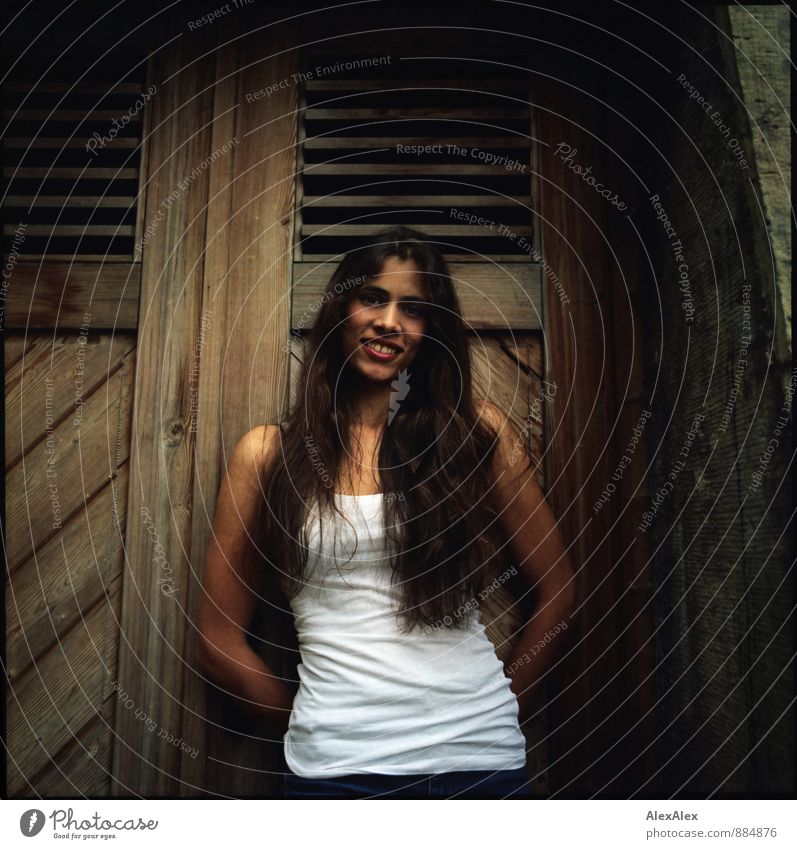 Michi Young woman Youth (Young adults) 18 - 30 years Adults Wooden door Wall (barrier) Undershirt Brunette Long-haired Smiling Laughter Esthetic Friendliness