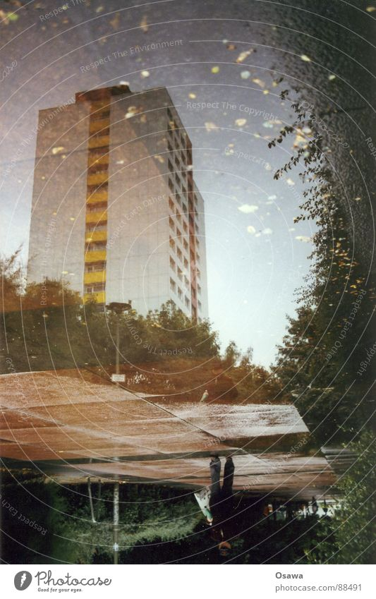 Liquid prefabricated building Building High-rise Puddle Man Australia Dreary Town East Reflection Friedrichshain Prefab construction Berlin Rain Cover