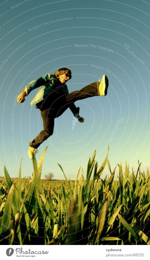 Jump into the field! III Hop Spring Meadow Grass Green Style Sunset Posture Blade of grass Worm's-eye view Sunbeam Kick Martial arts Man Fellow Field Straddle
