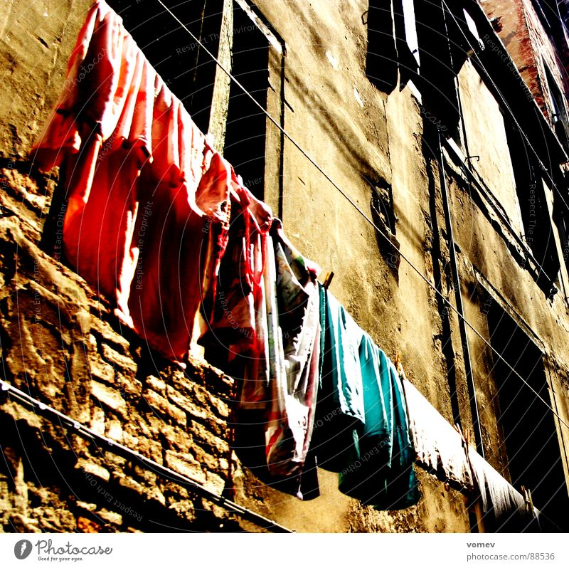 pure life Facade Laundry Clothesline Old fashioned Brown Wall (building) Derelict Life Rope Stone