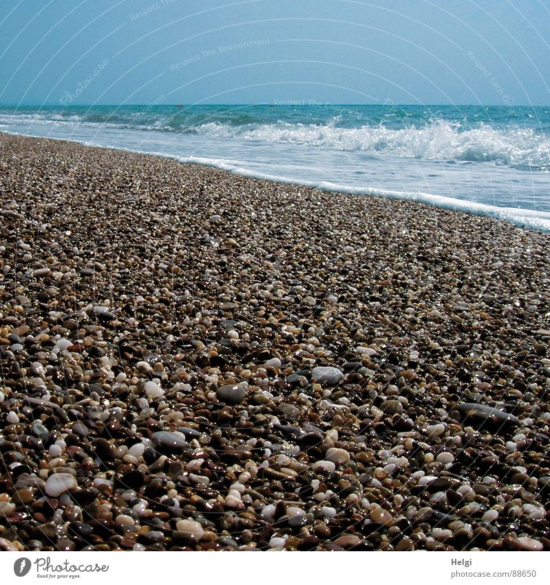 Pebble beach with surf on the Mediterranean Sea Colour photo Subdued colour Exterior shot Deserted Copy Space top Day Shadow Reflection Sunlight