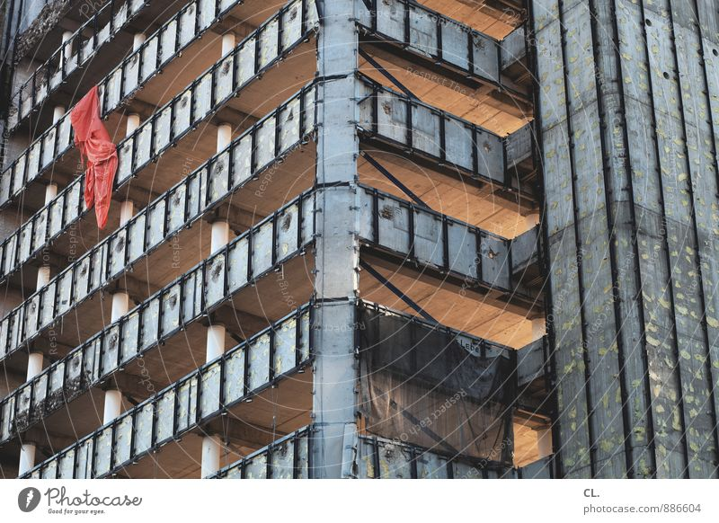City Red Wall (building) Architecture Wall (barrier) Building Facade Growth High-rise Large Tall Change Construction site Derelict Flag Manmade structures