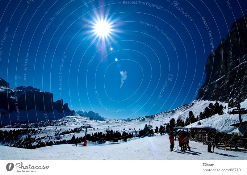 Arrival Skiing Snowboarding Ski resort Italy South Tyrol Cold Winter Human being Winter sports Physics Panorama (View) Mountain Above Sun Sky Blue Rock Sports