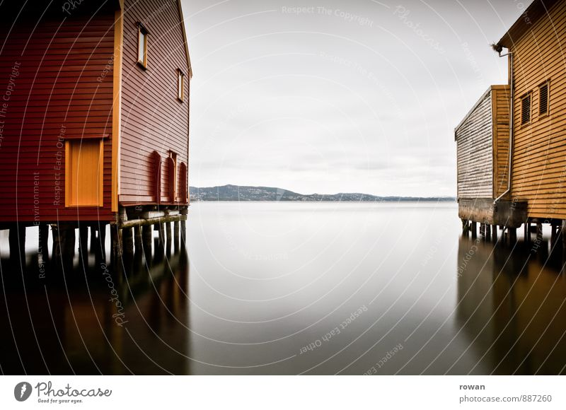 stand Coast Ocean Lake House (Residential Structure) Manmade structures Building Architecture Smoothness Reflection Wooden house Boathouse Bergen Red Yellow