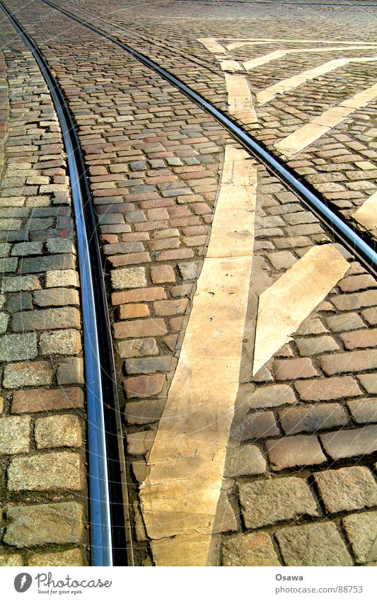 tram tracks Tram Railroad tracks Steel Granite Cobblestones Traffic lane Lane markings Transport Road traffic Striped Diagonal Traffic infrastructure Stone