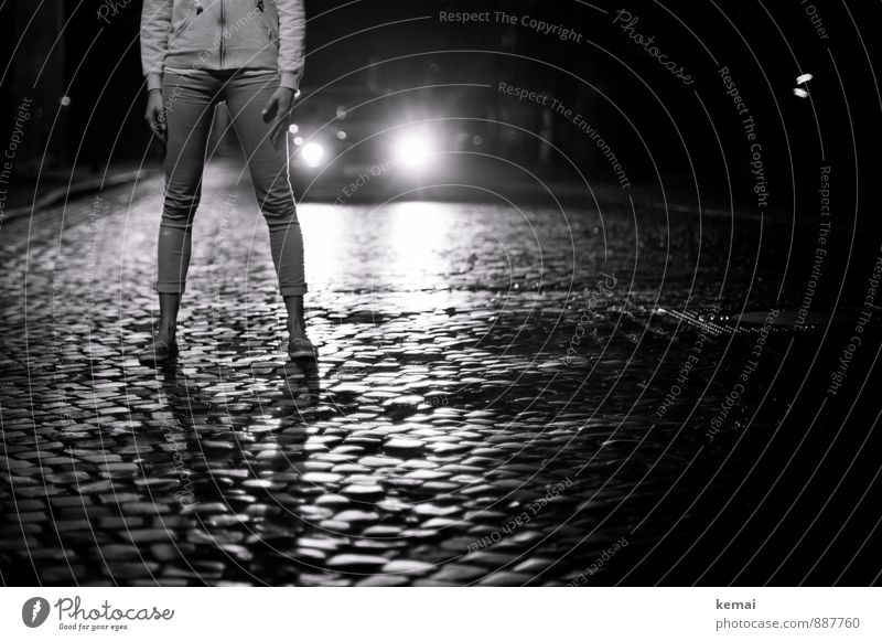 City lights in city nights Legs 1 Human being Town Downtown Old town Transport Road traffic Street Cobblestones Car Stand Wait Threat Dark Bravery