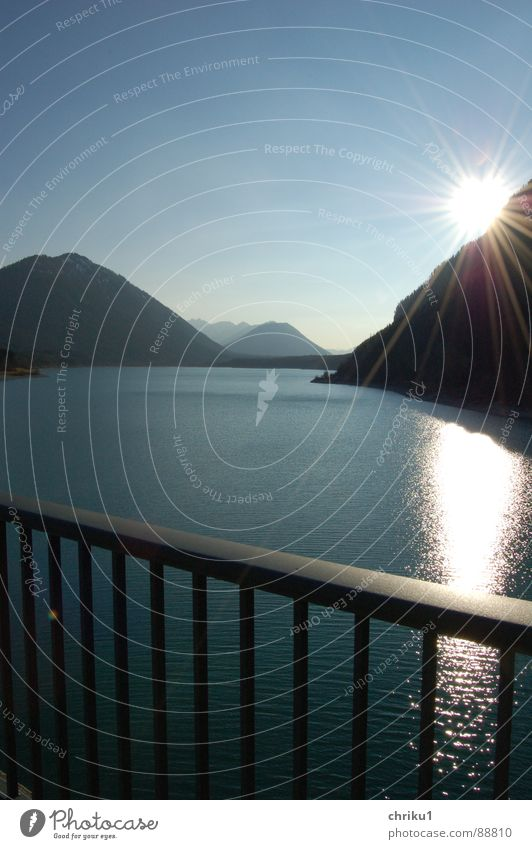 dam-at-lake_1 Bavaria Reservoir Lake Glittering Bridge railing Wet Sunbeam Body of water Relaxation Mountain range Leisure and hobbies Reflection Dark