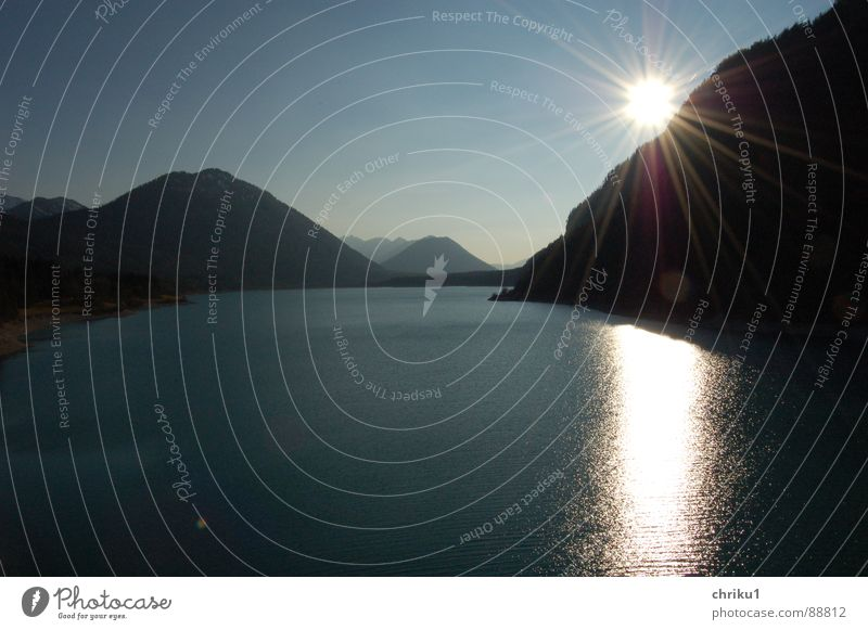 Water Sky Sun Blue Calm Far-off places Dark Relaxation Mountain Lake Glittering Wet Bridge Leisure and hobbies Bavaria