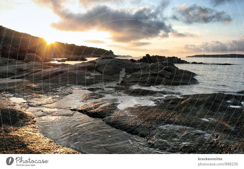 Sky Vacation & Travel Blue Sun Ocean Landscape Calm Clouds Beach Environment Yellow Coast Swimming & Bathing Rock Waves Island