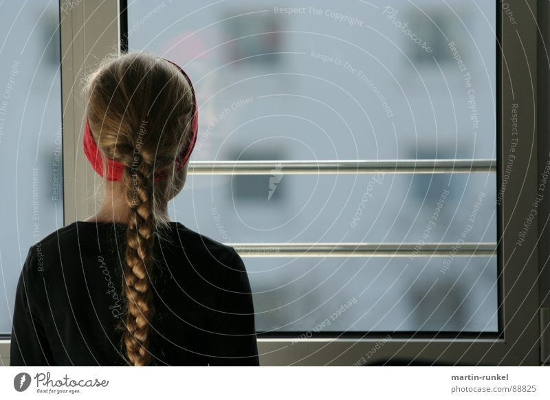 vision 2050 Girl Window Braids Red Gray Black Headband Loneliness Child Emotions Back Looking View from the window lonely girl red stringband View from a window