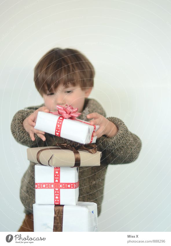 Human being Child Christmas & Advent Joy Emotions Boy (child) Happy Feasts & Celebrations Birthday Infancy Gift Surprise Toddler Luxury Anticipation Packaging