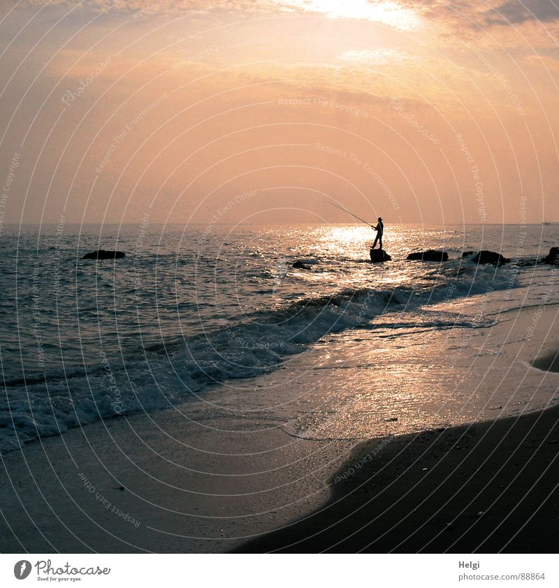 Silhouette of an angler on the beach in the evening sun Joy Relaxation Leisure and hobbies Fishing (Angle) Vacation & Travel Summer Sun Beach Ocean Waves