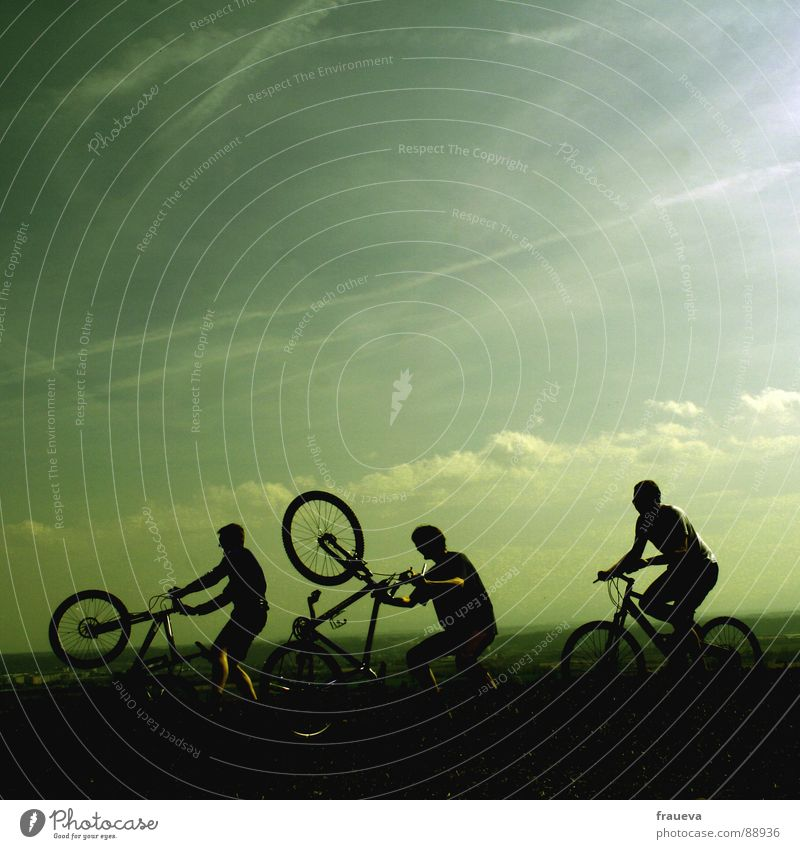 playing boys Cycling Bicycle Man Masculine Motorcyclist Romp Clouds Green Playing Exterior shot Happiness Exuberance Joy Group Sports willing Landscape Sky Men