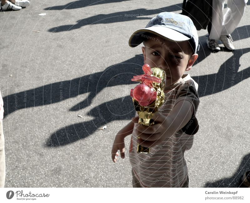 Human being Child Sun Summer Playing Emotions Boy (child) Gold Stripe Asphalt Anger Force War Jetty Trashy Toys