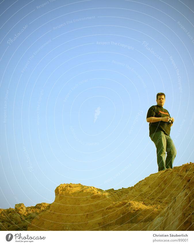 Man Sky Blue Yellow Mountain Sand Germany Jeans USA T-shirt Beach dune Grand Canyon
