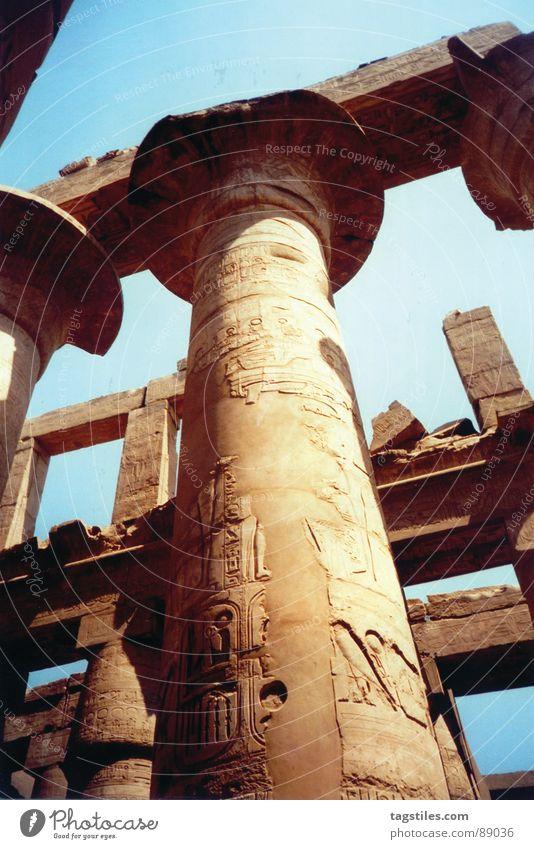 Rising high - Amun Ra, Luxor - Egypt Column Hieroglyph Temple Deities Decline Ancient Pharaohs Beige Monumental Manmade structures Africa Landmark Art