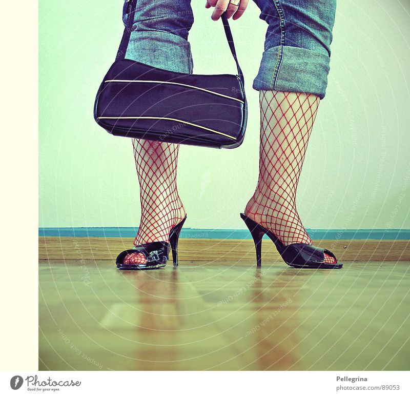 Woman Wall (building) Legs Feet Footwear Floor covering Jeans Net Stockings Bag Parquet floor Human being