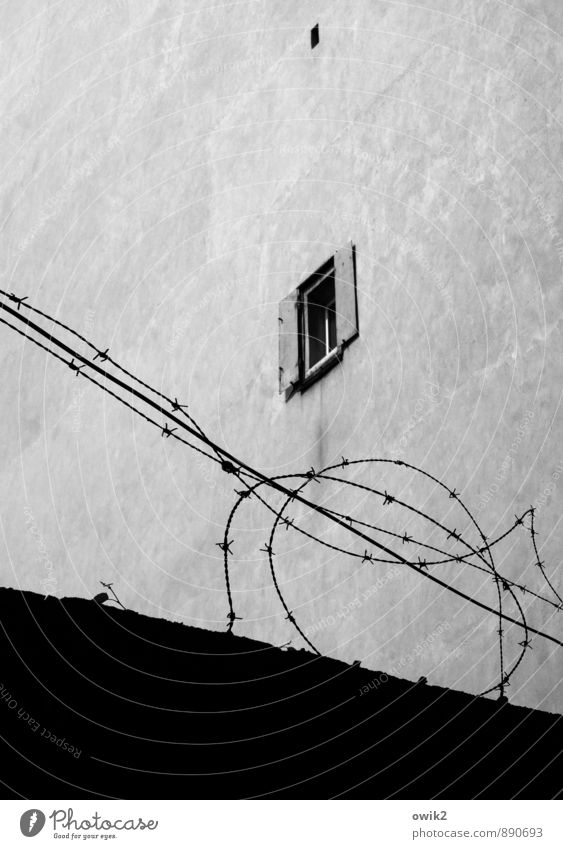 Living safely Wall (barrier) Wall (building) Facade Window Small Above Safety Protection Safety (feeling of) Orderliness Dangerous Thrifty Barbed wire
