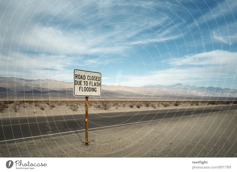 reference Environment Nature Plant Clouds Desert Death valley Nationalpark Transport Traffic infrastructure Street Logistics Road sign High tide Warn Safety Dry