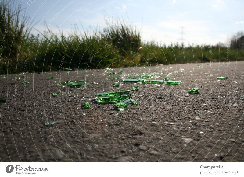 Bicycle path with obstacle Bottle of beer Cycle path Green Grass Asphalt Anger Aggravation Derelict Alcoholic drinks Lanes & trails Glass Street Nature Dirty