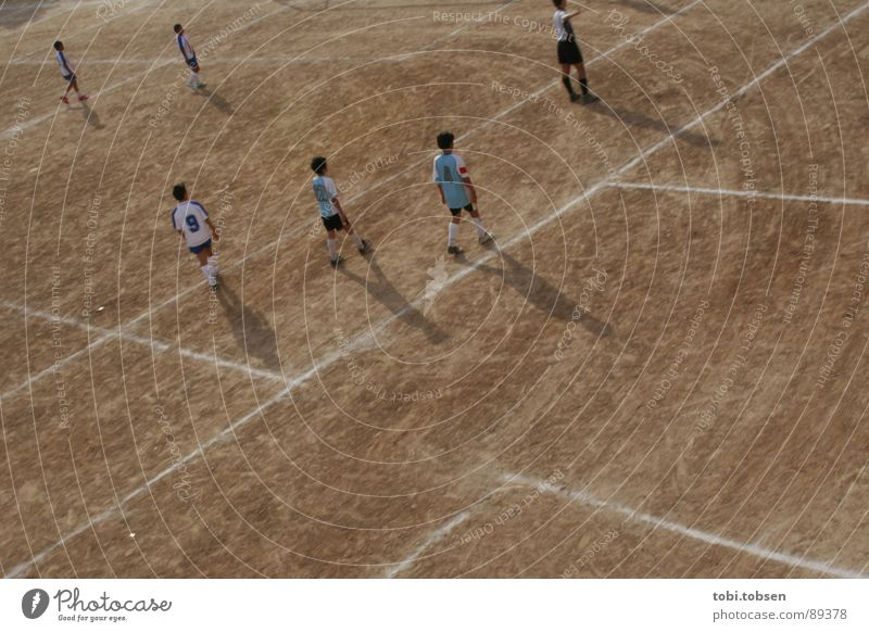 Human being Child Sports Soccer Bright Brown Perspective Places Sports team Playing field Beige Strike Ball sports Darken Valencia Sporting grounds