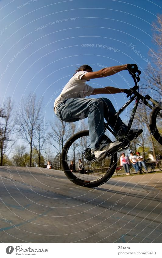 Youth (Young adults) Sky Tree Summer Sports Jump Style Park Warmth Contentment Bicycle Tall Action Modern Dangerous Driving