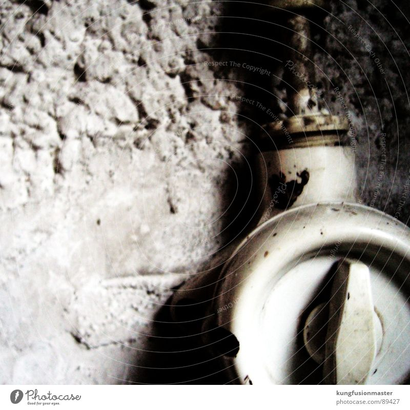 Light is still burning in the cellar Switch Light switch Rotary switch Old Bright Wall (building) White Plaster Electrical equipment Technology Stone Minerals