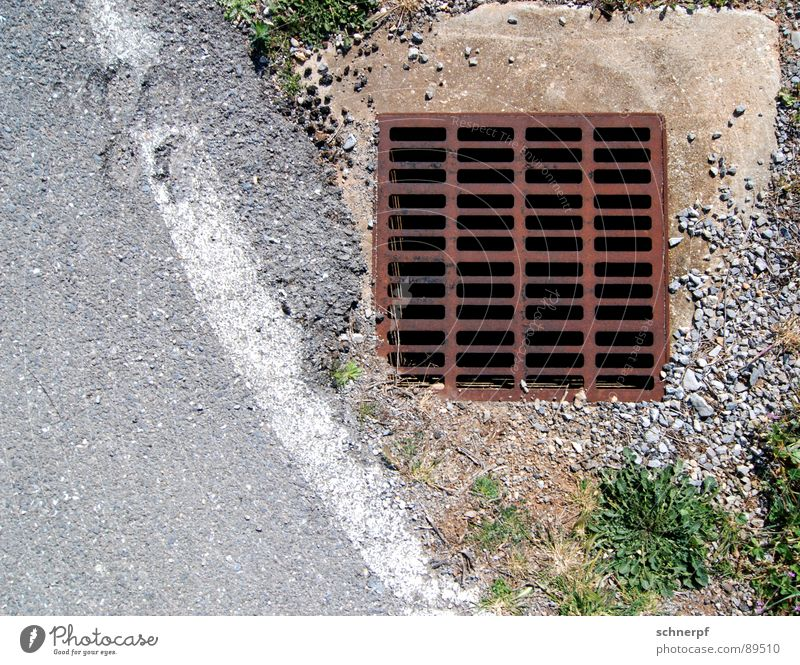 A Gulli Gully Iron Wayside Drainage Drainage system Rust Traffic infrastructure Earth Sand Detail Street Stone water inlet Sewer