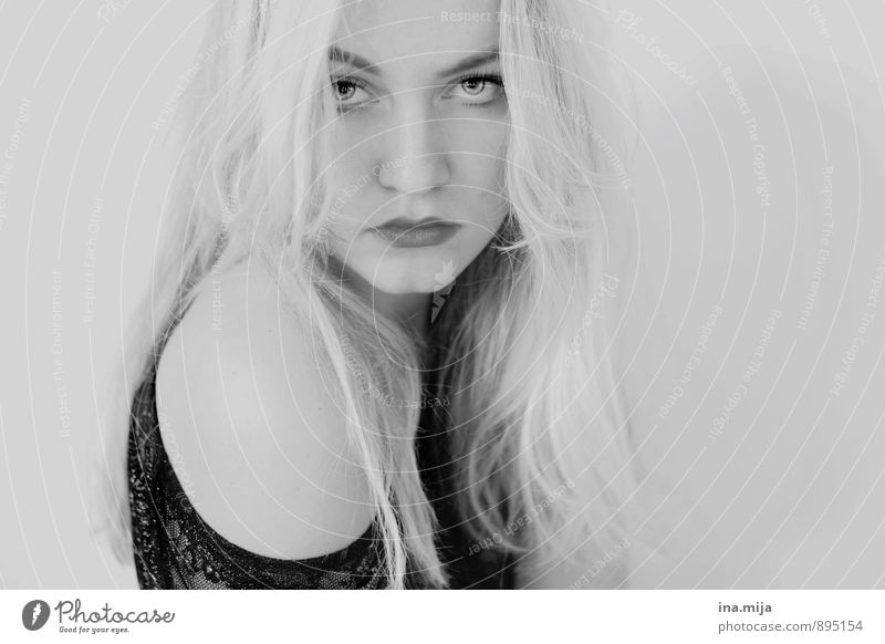 Young blonde woman Human being Feminine Face 1 Blonde White-haired Long-haired pretty Uniqueness Emotions Moody Virtuous Reluctance Disappointment Loneliness