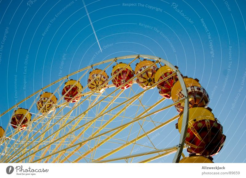 There's a fair in heaven Fairs & Carnivals Ferris wheel Airplane Aspire Round Family outing Iron Showman Services Joy Leisure and hobbies Sky Blue Circle Tall