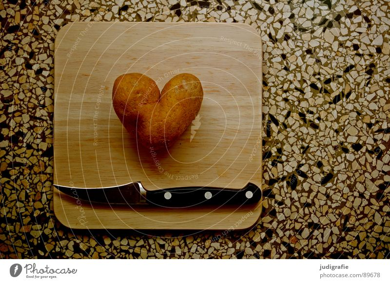 heartache Colour photo Interior shot Day Food Nutrition Vegetarian diet Knives Kitchen Heart Love Dark Kitsch Lovesickness End Cooking Chopping board Bulb Cut