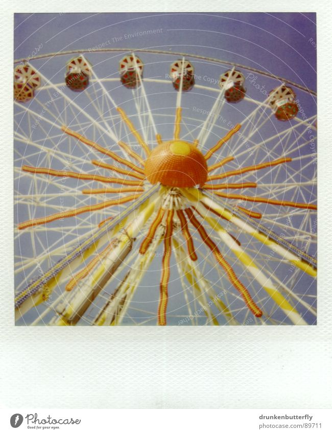 skyrocketing Ferris wheel Fairs & Carnivals Rotate Circle Summer Yellow Leisure and hobbies Sky Blue Joy Polaroid Orange Tall