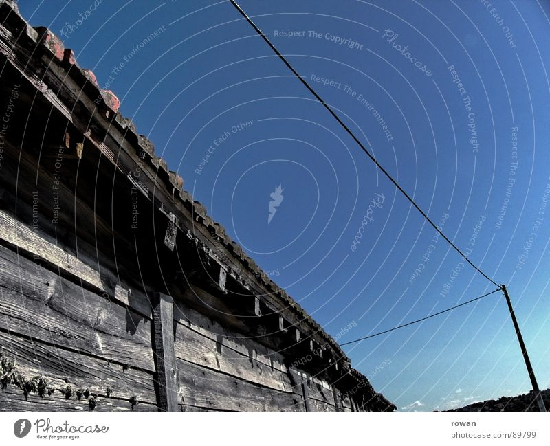 sheds Shed Wooden house Cable Electricity pylon Grayed Wall (building) Derelict Transience Barn Americas Old Warmth Hut salt reservoir Blue sky Worm's-eye view