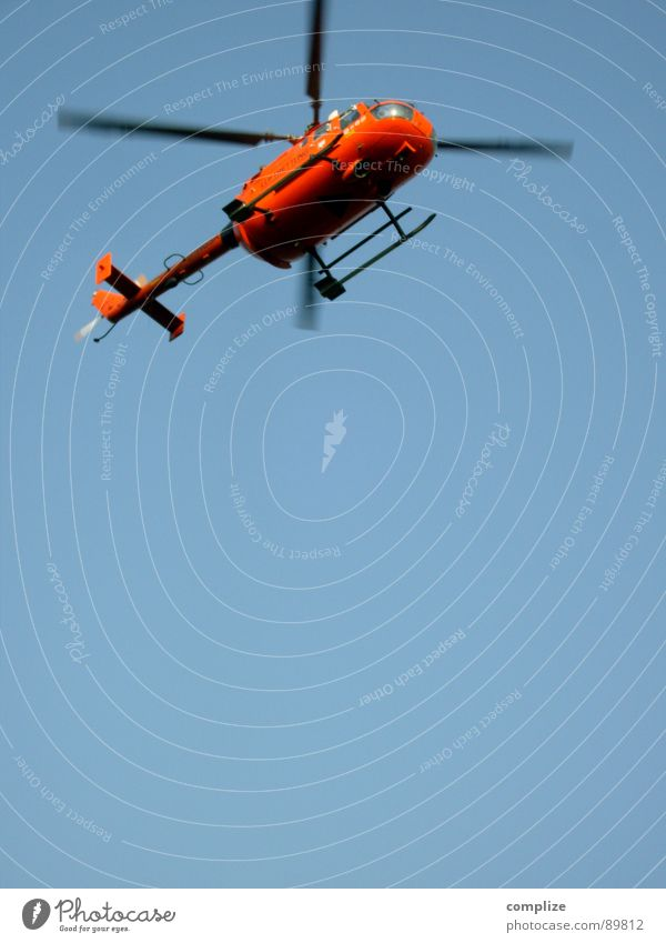 flight stuff! Helicopter Airplane Emergency doctor Doctor Rescue Lifesaving Savior Aviation Trust Orange Blue Blue sky heli Rotor crash flying doctors