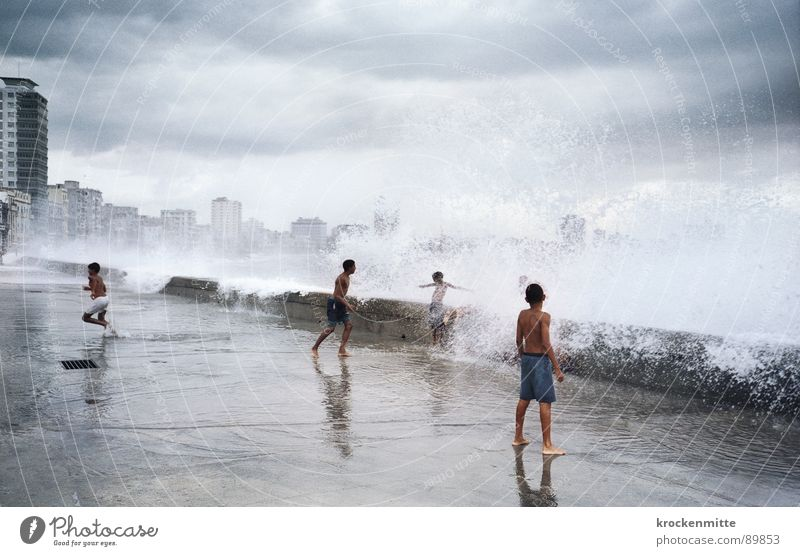Child Vacation & Travel Water Ocean Joy Clouds Boy (child) Playing Waves Multiple Tall Fresh Wet To enjoy Risk Refreshment
