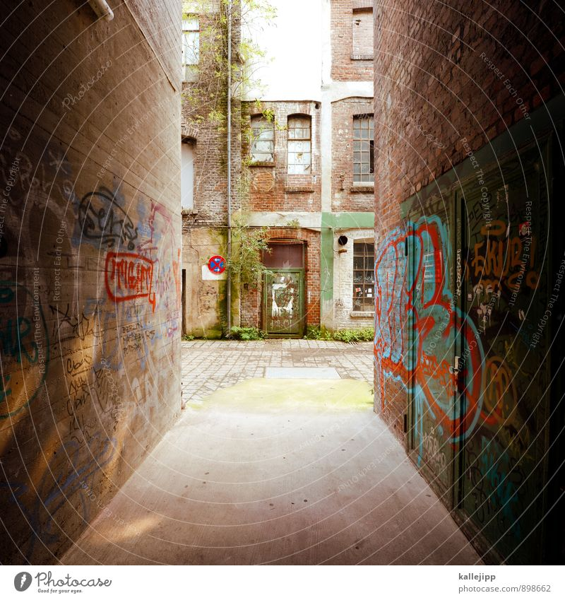 gas Town House (Residential Structure) Industrial plant Factory Wall (barrier) Wall (building) Facade Window Door Dark Alley Narrow Graffiti Brick Colour photo