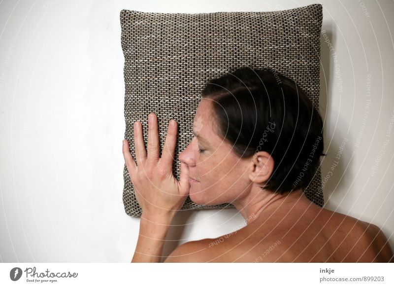 have a nap Lifestyle Well-being Contentment Relaxation Calm Leisure and hobbies Woman Adults Face Hand 1 Human being 30 - 45 years Cushion Pillow Smiling Lie