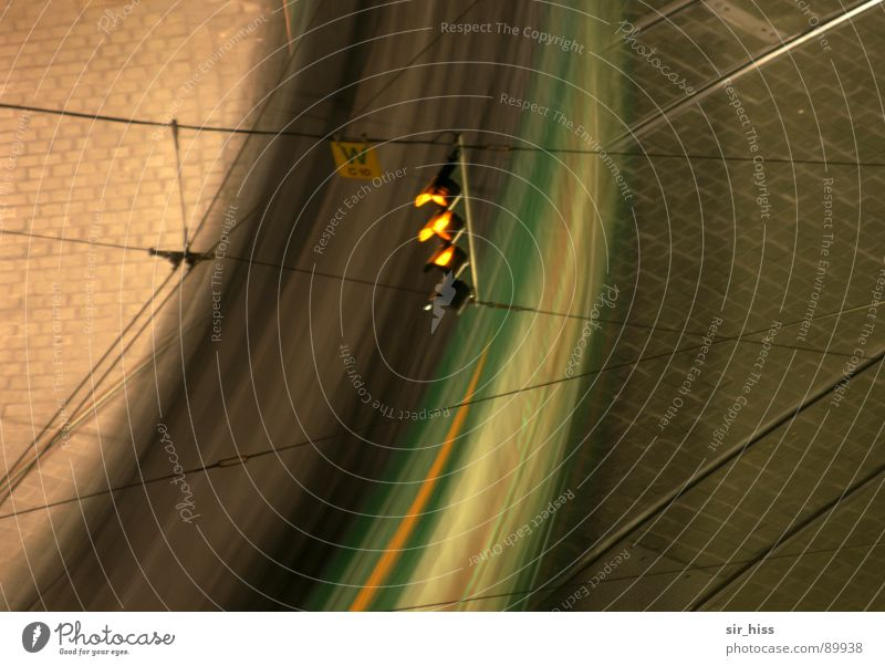 hurry home Overhead line Electricity Round Railroad tracks Traverse Curved Traffic infrastructure Detail Transport Cobblestones light signal system Frequency
