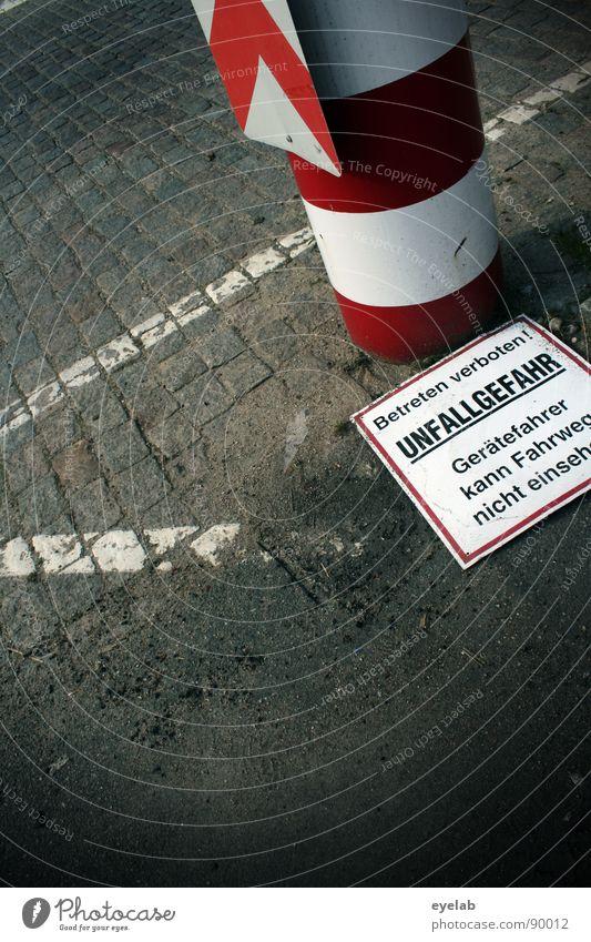 Hazard warnings now finally also for fallen persons Asphalt Tar Stripe White Black Gray Dangerous Red Column Reflector Tin Text Typography Sand Sidewalk Flat
