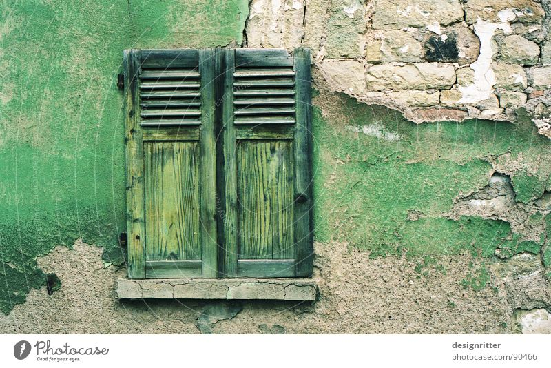 discoloured transverse Window Shutter Wood Green Wall (barrier) Plaster Tone-on-tone Crumbled Ruin Wood flour Detail Colour Wooden board Stone Old color finery