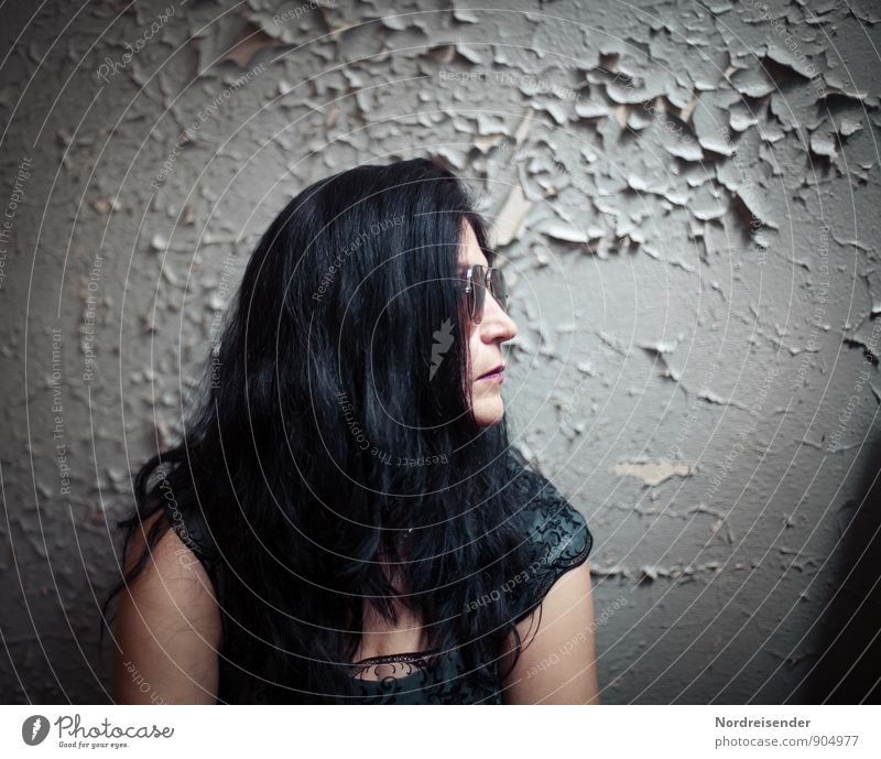 Woman with long black hair in retro look in front of an old wall Lifestyle Style Human being Feminine Adults 1 Wall (barrier) Wall (building) Fashion