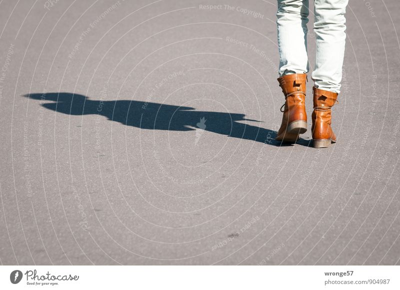 Human being Woman Adults Movement Feminine Gray Legs Going Brown 45 - 60 years Trip Asphalt Pavement Boots Shadow play