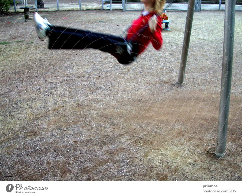 Human being Playing Swing Playground