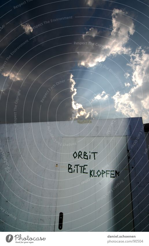 please knock!??? Clouds Light Dark Wall (building) Detail Letters (alphabet) Characters Sky Surrealism Abstract Sun Bright