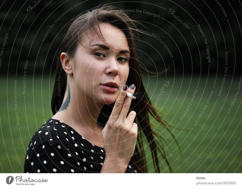 Human being Youth (Young adults) Beautiful Young woman Dark Feminine Park Wind Authentic Observe Cool (slang) Dress Tattoo Smoking Brave Fatigue